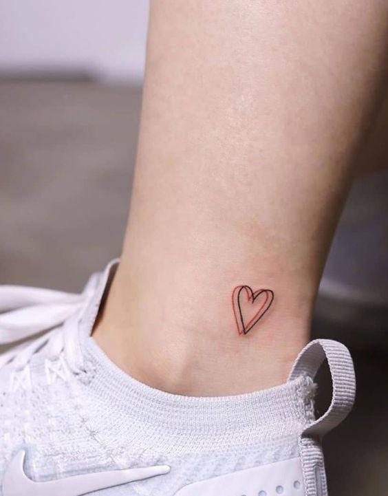 little heart tattoo on leg