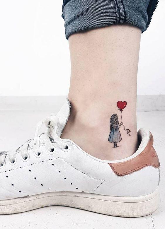 girl + Heat tattoo on foot