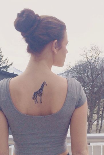 giraffe small tattoo on girl back