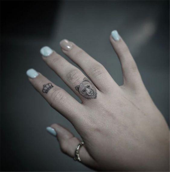pretty tattoo on finger for girls