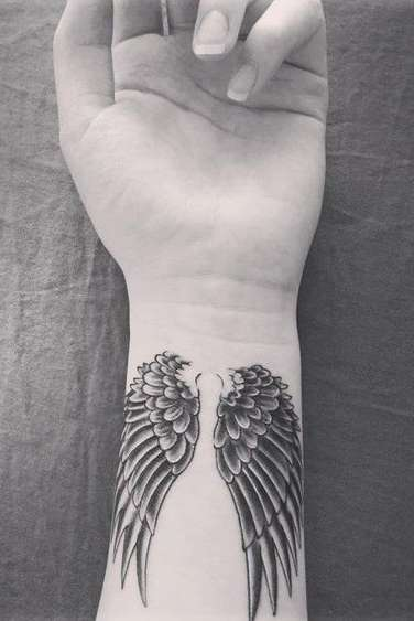 angel wings tattoo on wrist for womens