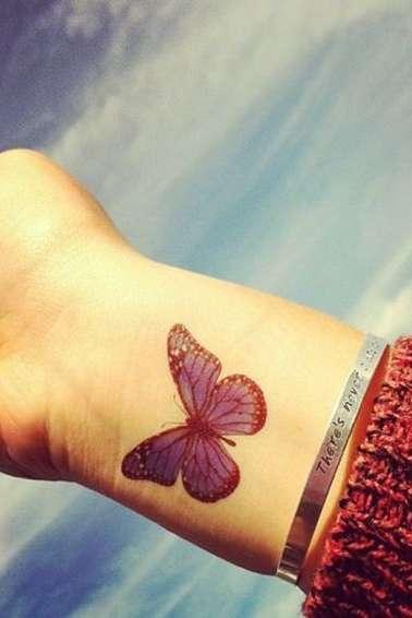 butterfly wrist tattoo for girls