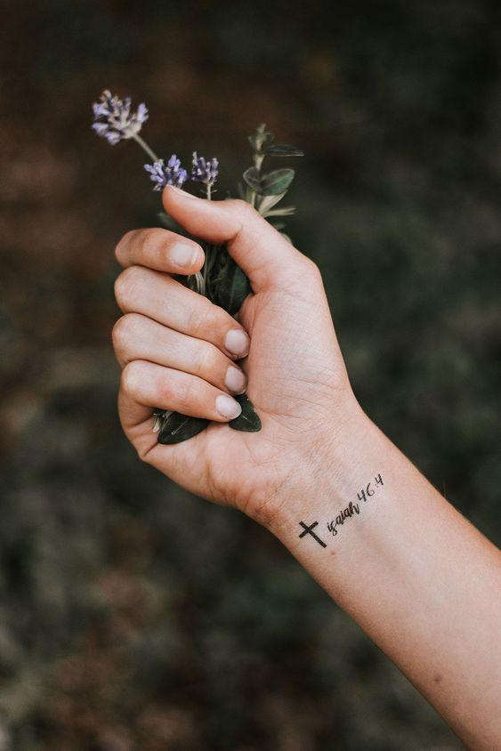 cross tattoo on wrist for females