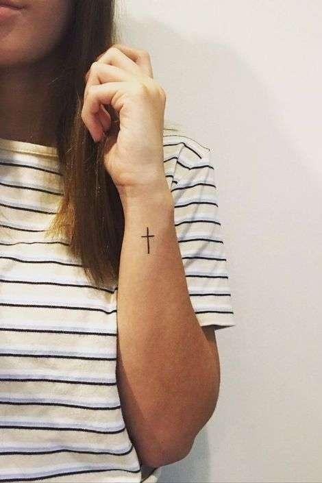 cross tattoo on side wrist for females