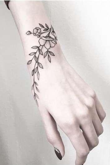 flower wrist tattoo for girls