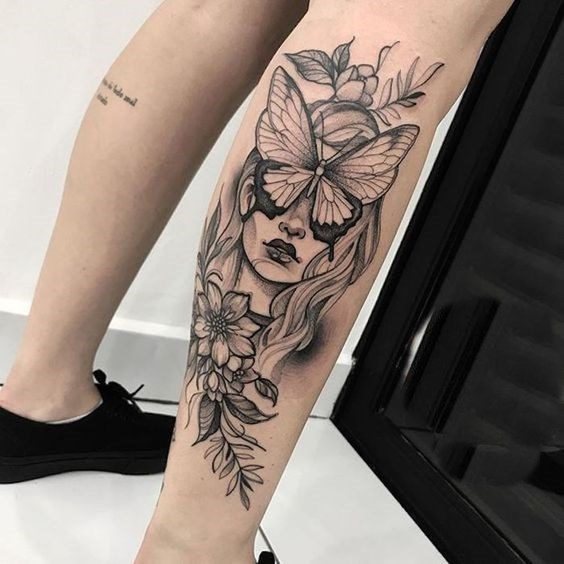 girl face and follower tattoo on leg