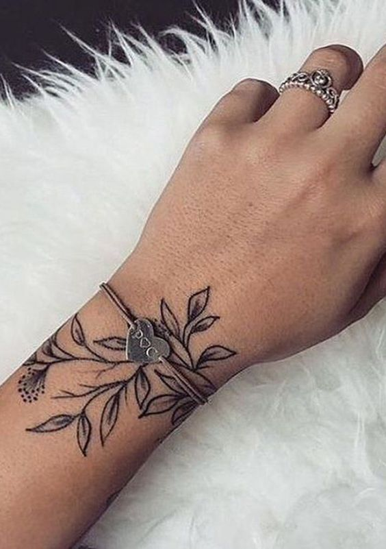 rose tattoo on wrist for females