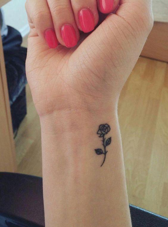 rose tattoo on wrist for women
