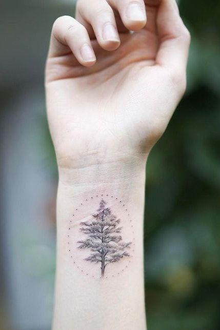 tree wrist tattoo for women