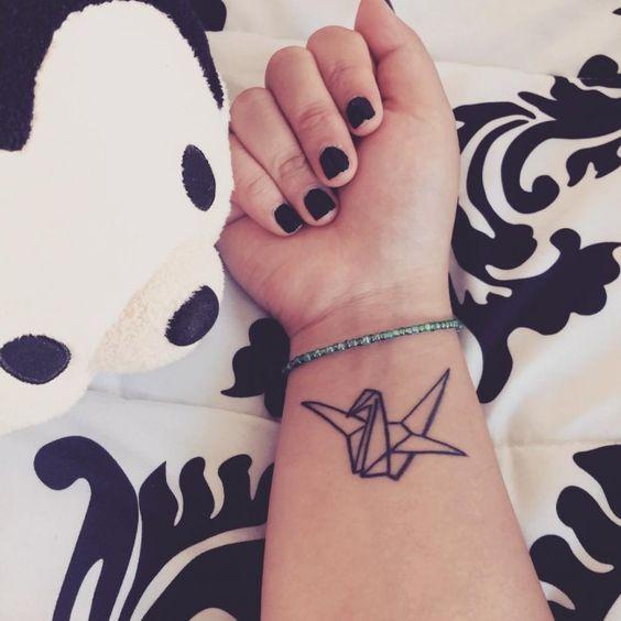 birds wrist tattoo for girl