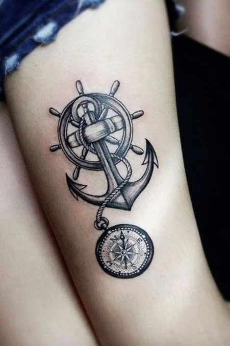 compass thigh tattoo for women