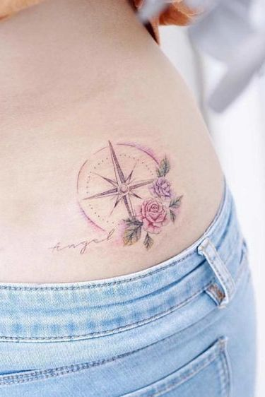 compass and flower mix tattoo