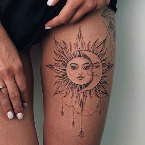 sun and moon tattoo on thigh