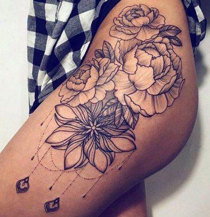 flower thigh tattoo for women