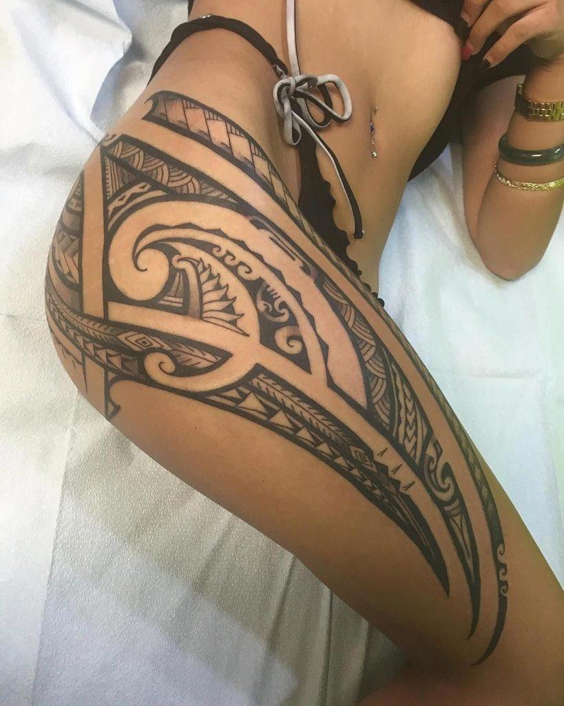 tribal thigh tattoo