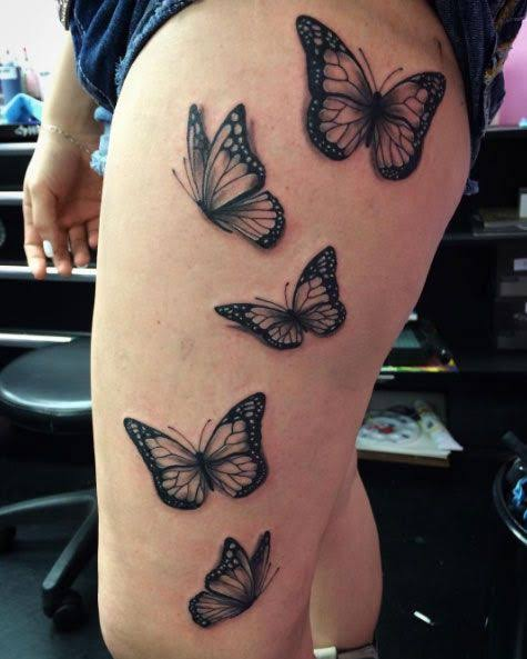 butterfly thigh tattoo
