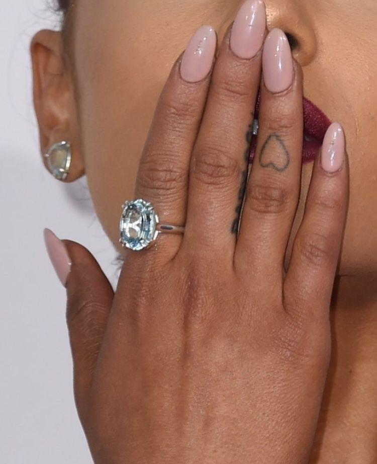 ariana grande finger tattoos