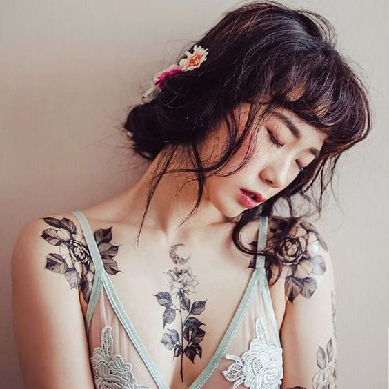 flower chest tattoos for women