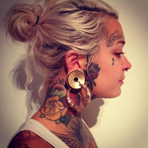 attractive tattoo on neck for females