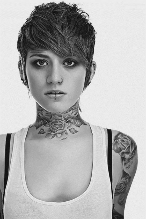 attractive tattoo on front neck
