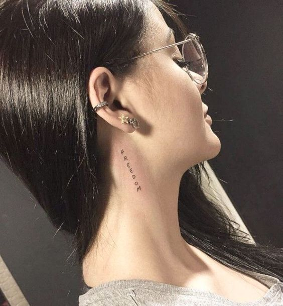 Name tattoo on side neck