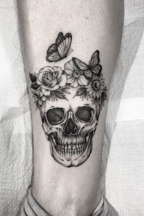 leg skull tattoos with butterfly