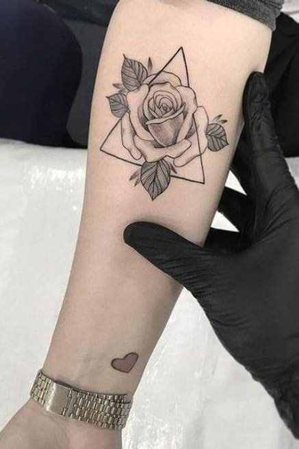 geometric shape tattoo on forearm