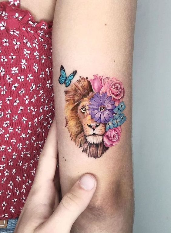 Upper arm backside lion + Flower Tattoo