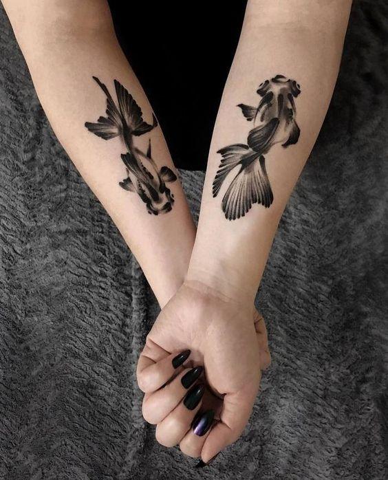 fish tattoo on wrist