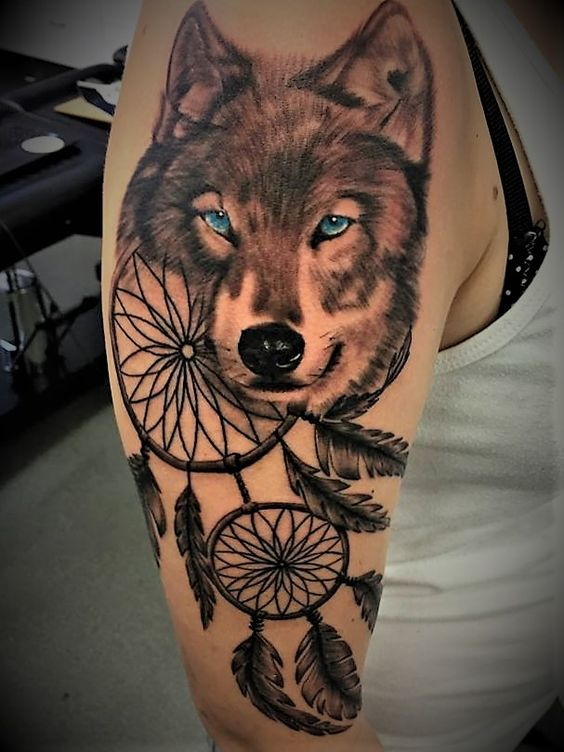 15dream catcher and wolf tattoo on upper arm