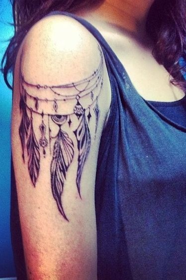 feather tattoo on shoulder