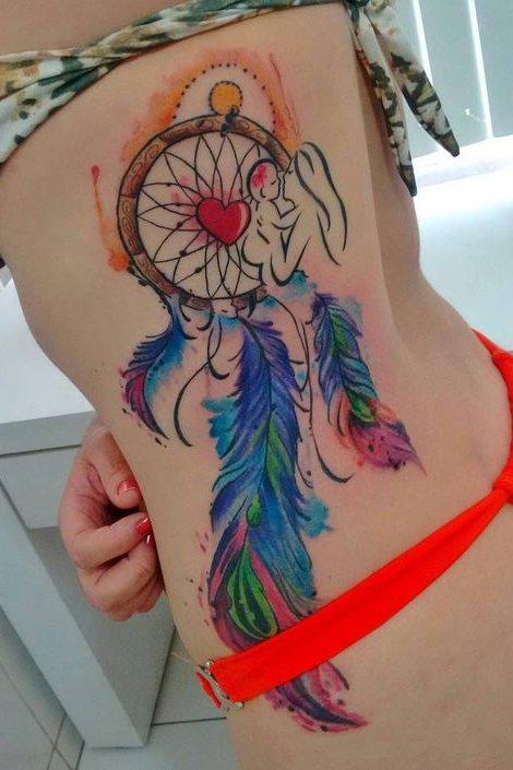 dream catcher tattoo on rib cage