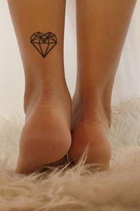diamond heart tattoo on back leg