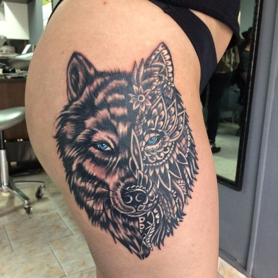 wolf tattoo on thigh
