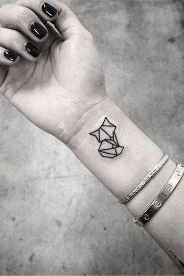 geometric animal tattoo on wrist