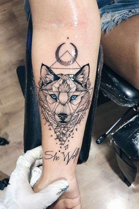 wolf tattoo on wrist
