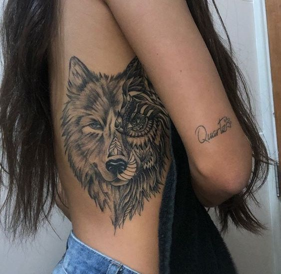 wolf tattoo on rib