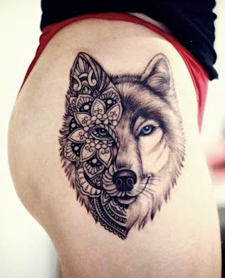 half face with flower wolf tattoo on thigh