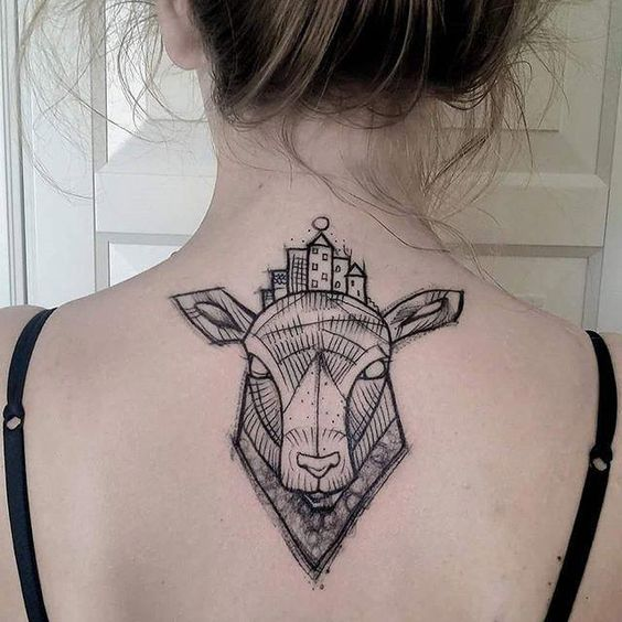 geometric animal face tattoo on back