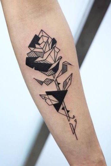 geometric rose tattoo on sleeve