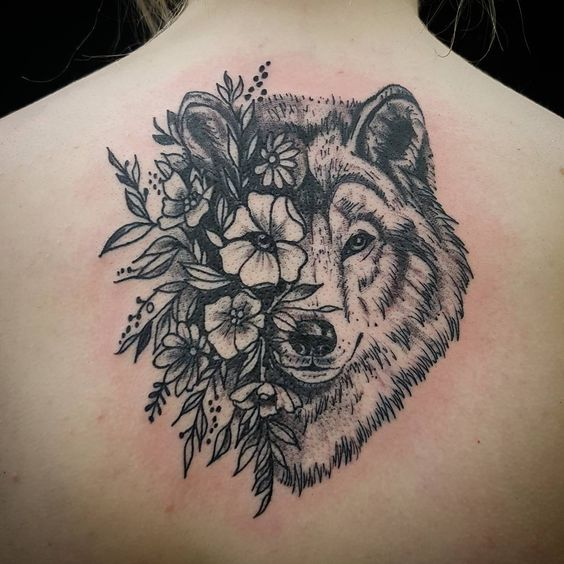 flower + wolf tattoo on back