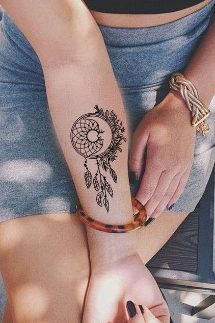 dream catcher tattoo on forearm