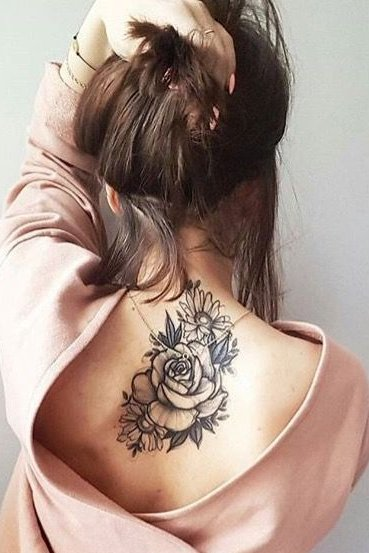Rose flower tattoo on back for females