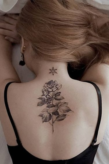 flower tattoo on back for females