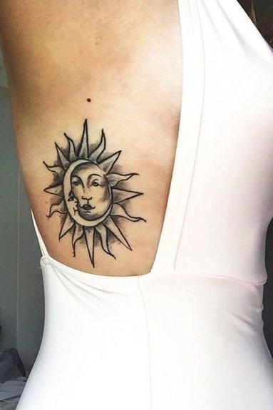 sun tattoo on rib