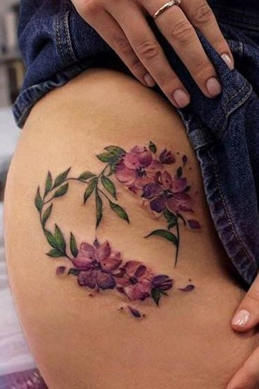 flower tattoo on groin for females