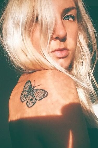 Butterfly tattoo on back