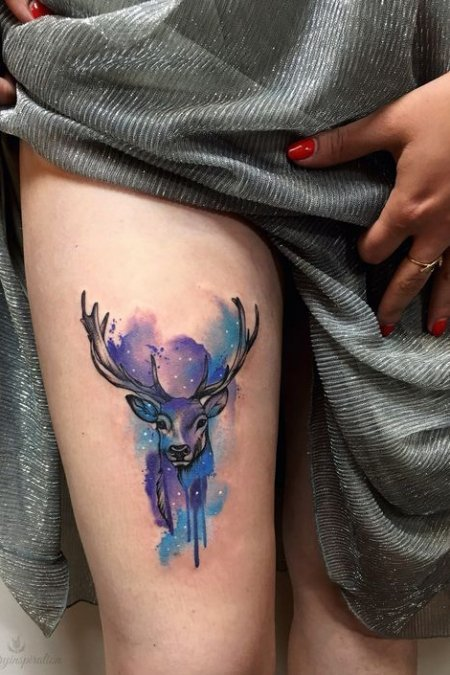 watercolor tattoo on thigh