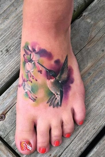 birds watercolor tattoo on foot
