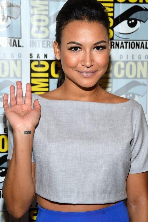 Naya Rivara Showing Wrist Tattoo and wearing grey dress